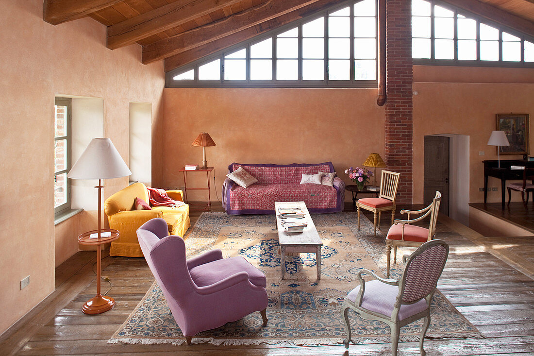 Various chairs and upholstered furnishings in living room