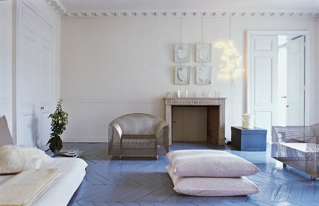 Herringbone parquet floor painted dove-grey in period building