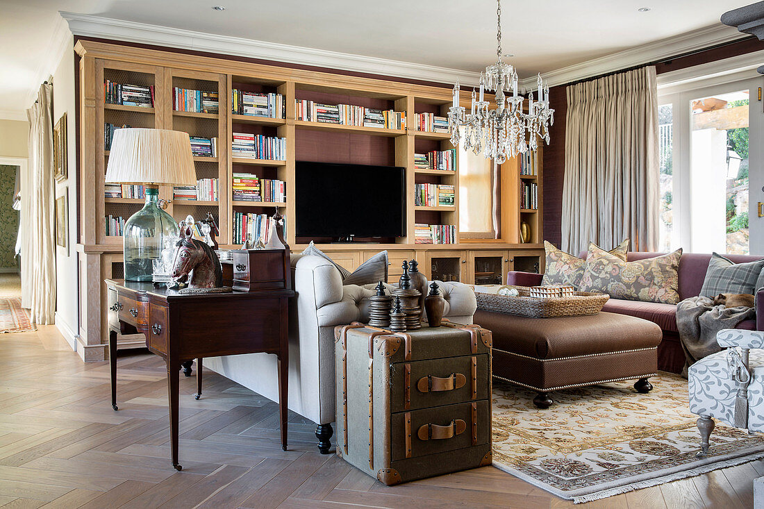 Sofa and fitted cupboards in elegant, classic living room