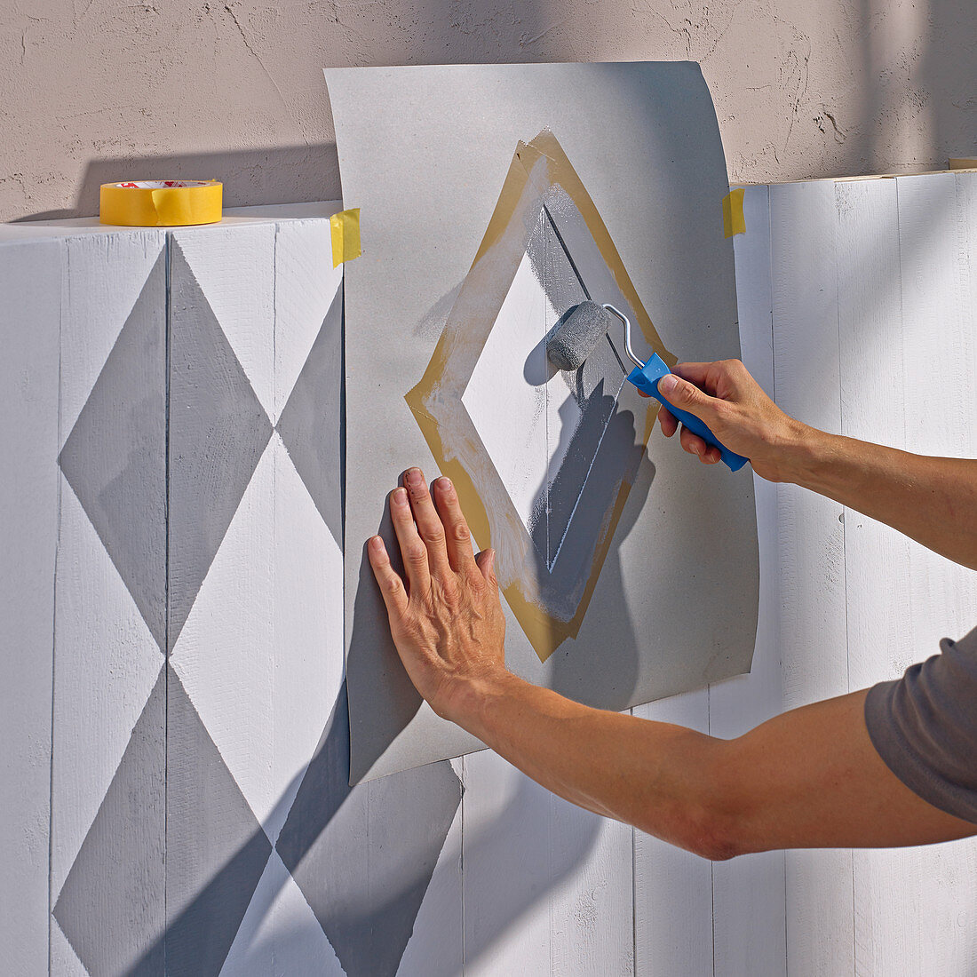 Applying a diamond pattern to board wall using a template