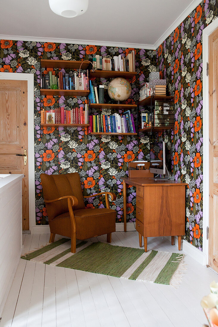 Work area in hallway with colourful floral wallpaper