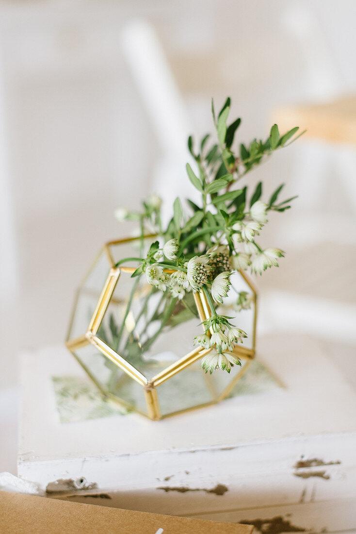 Flowers in geometric vase