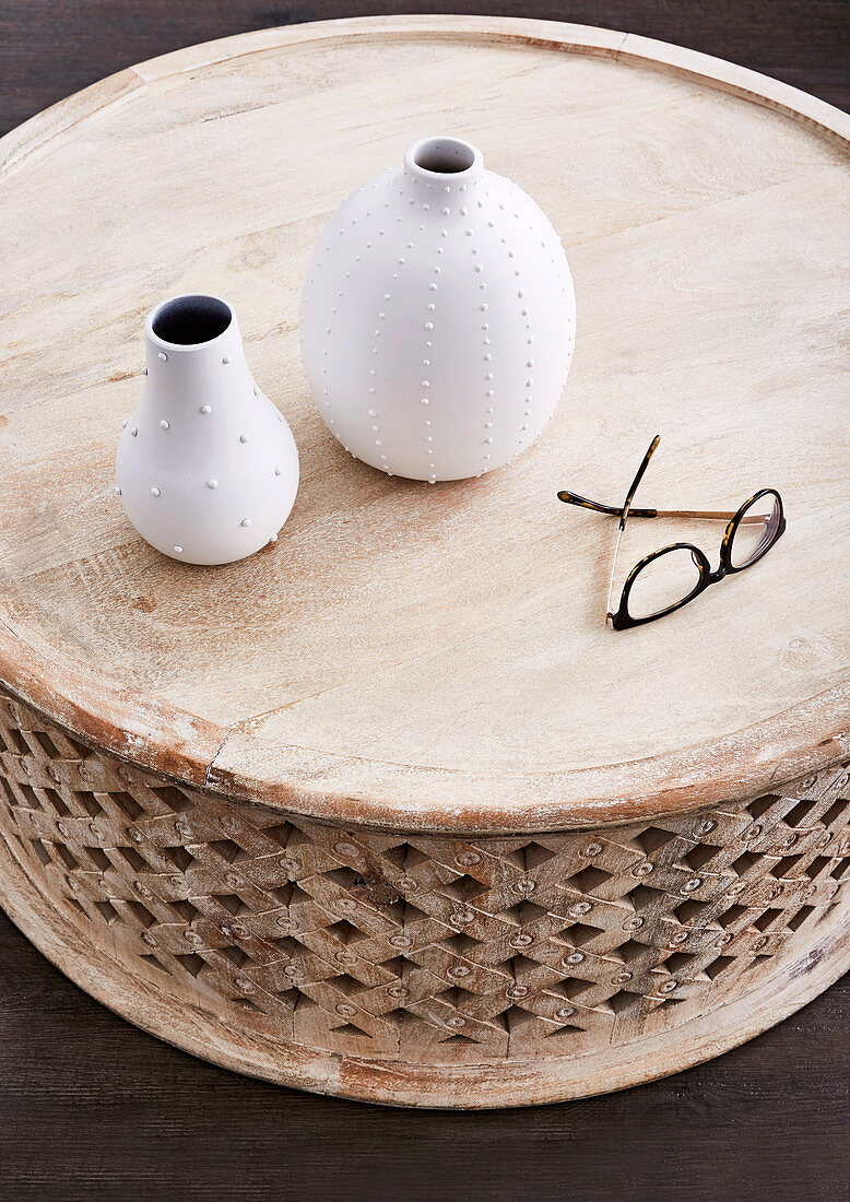 Round coffee table with vases and glasses