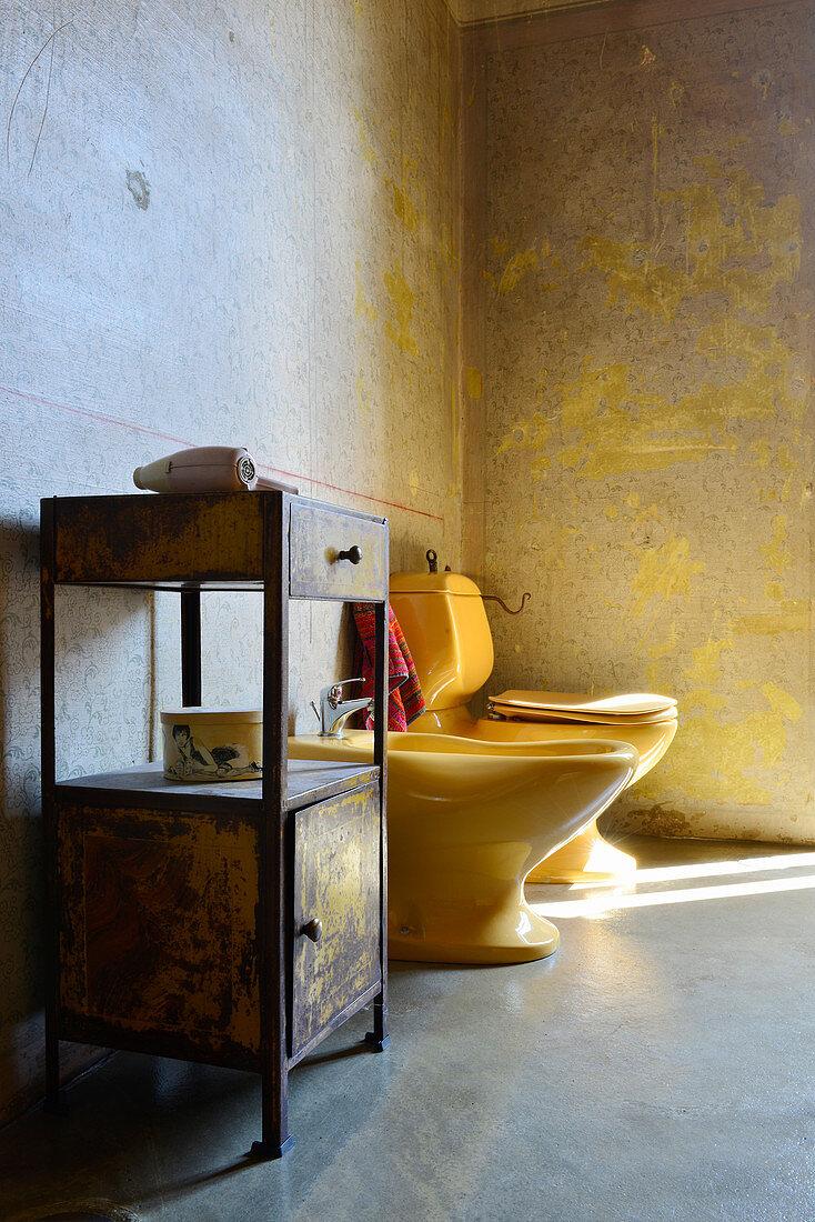Vintage-style side table, bidet and toilet in bathroom