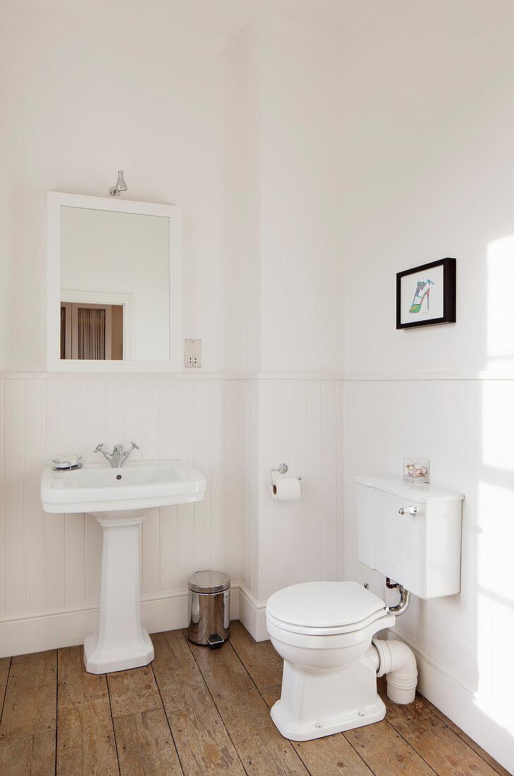Vintage toilet and sink in minimalist bathroom