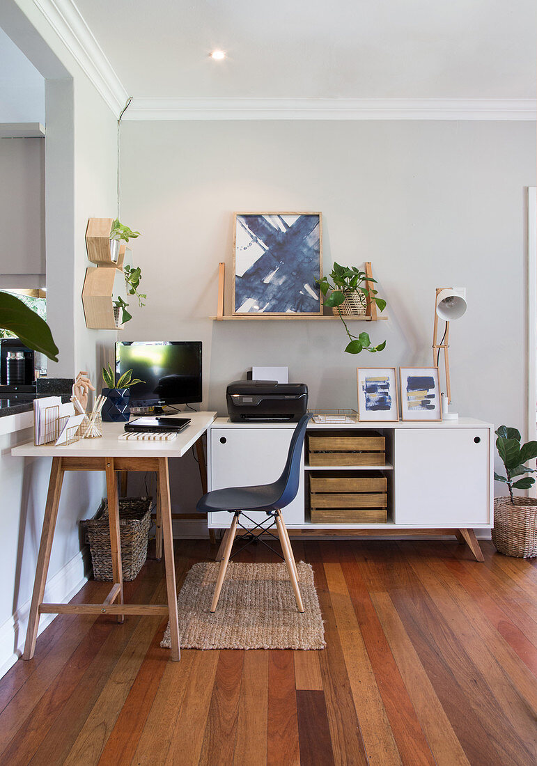 Study with white table and sideboard in corner