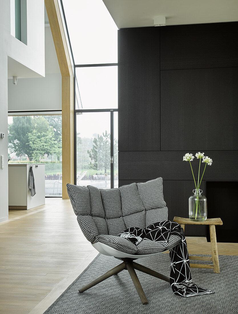 Upholstered designer armchair in modern architect-designed house