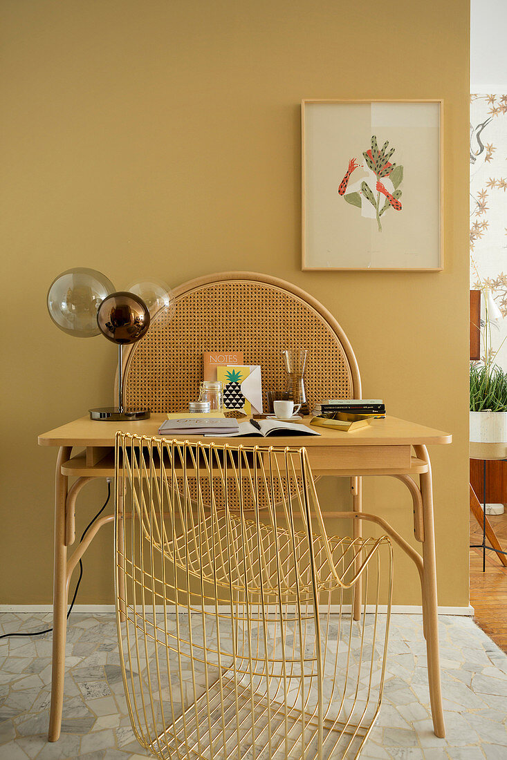 Small desk with table lamp and designer chair