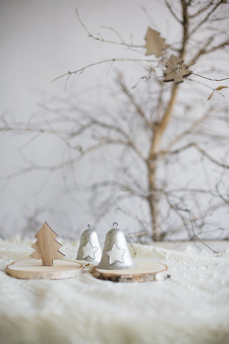 Vintage-style bells and Christmas trees on slices of tree trunk