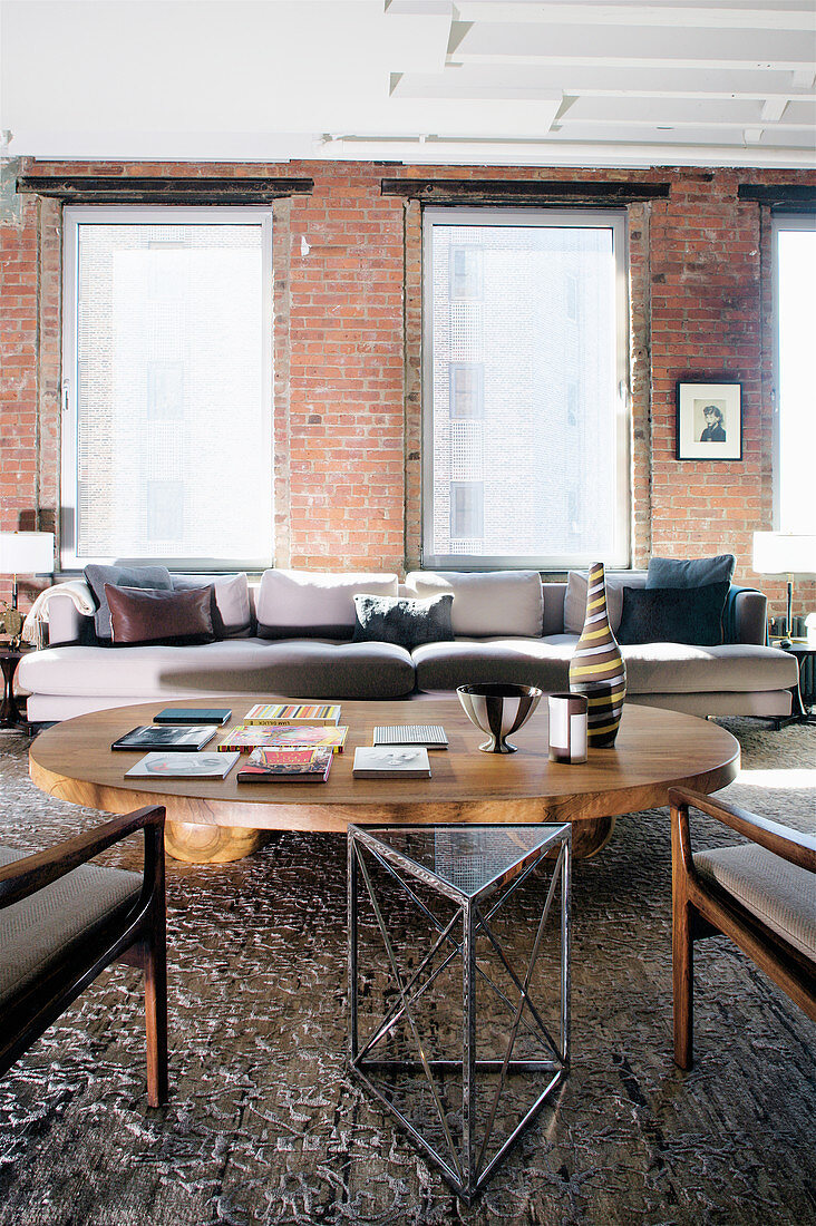Living area in earth tones in loft apartment with brick walls