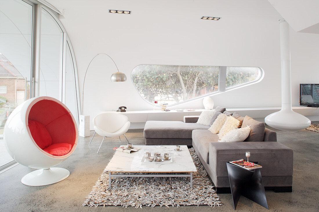 Designer furniture in living room of architect-designed, futurist house
