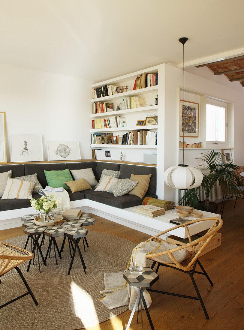Masonry sofa and shelves in Mediterranean living room
