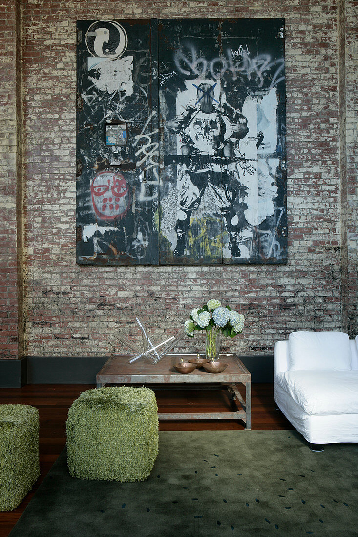 Street art on brick wall in industrial-style living room