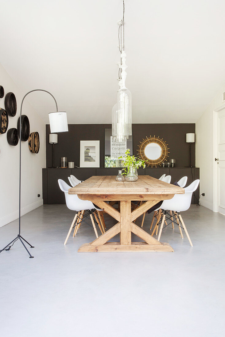 Wooden table and classic chairs in dining room
