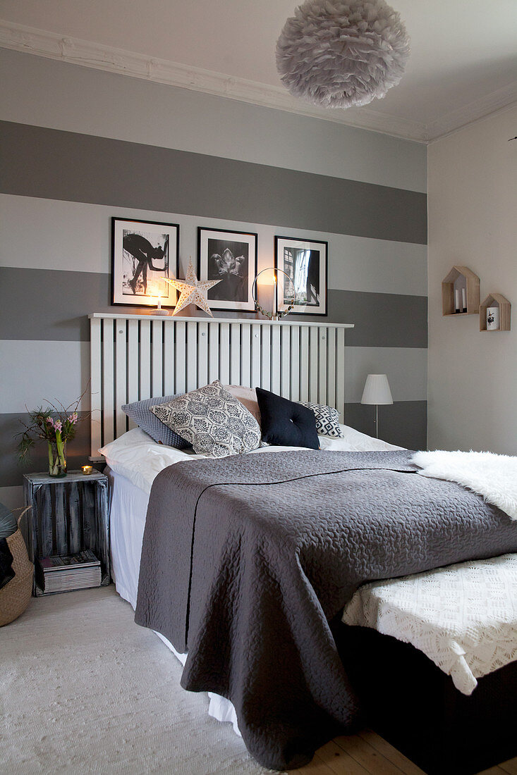 Wall decorated with wide horizontal stripes in shades of grey