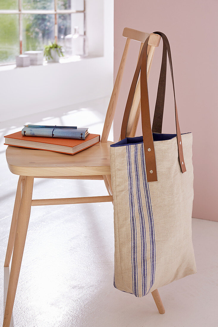 A DIY shopping bag made from linen with leather straps