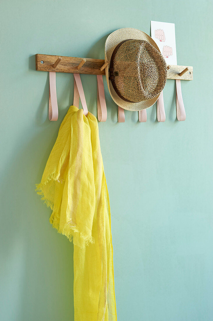 A DIY coat rack with leather loops