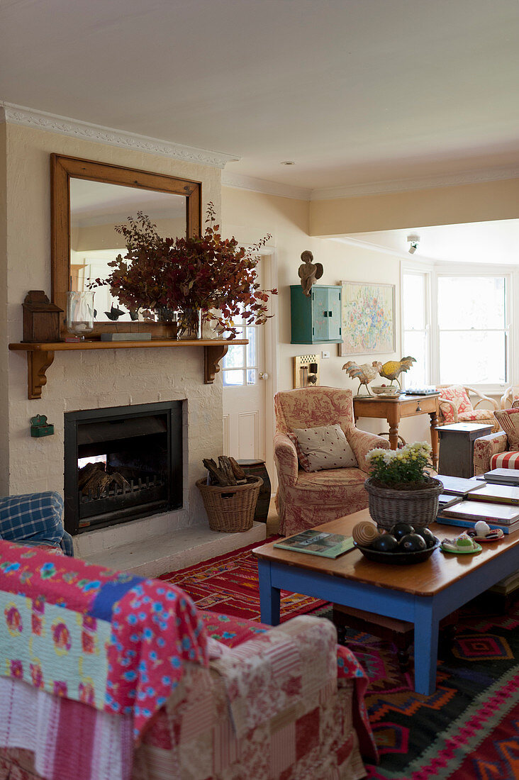 Cosy living room in country-house style with open fireplace