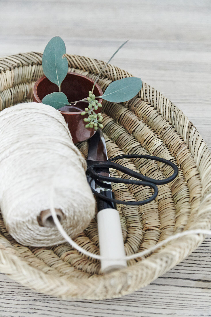 Decorative storage basket made from natural fibres