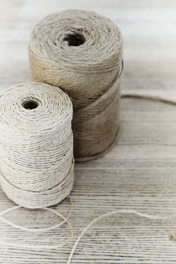 Two reels of jute twine in different natural shades