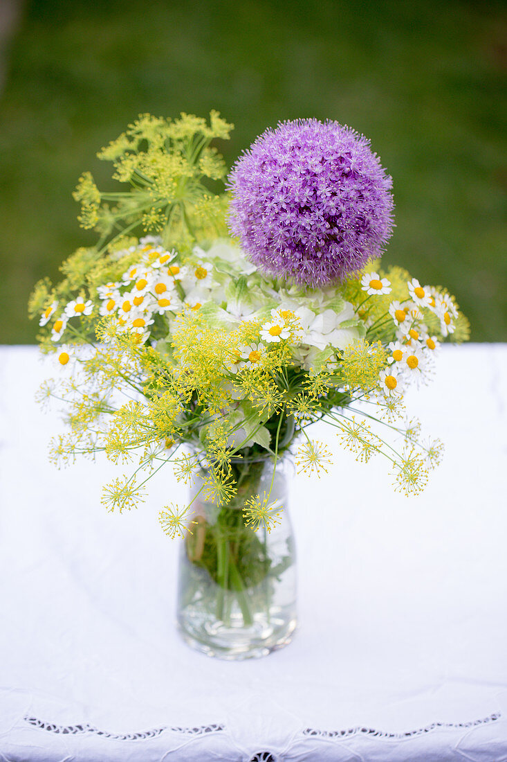 Bouquet of dill, chamomile and purple allium flowers