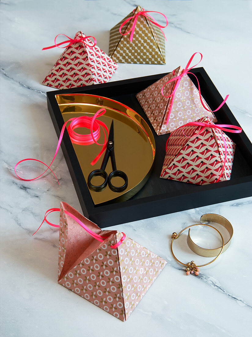 Homemade pyramid boxes as gift boxes or as table decorations