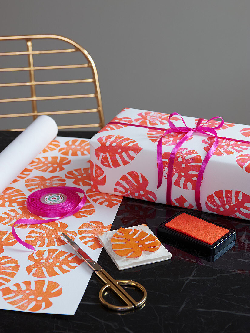Homemade wrapping paper decorated with coloured stamps