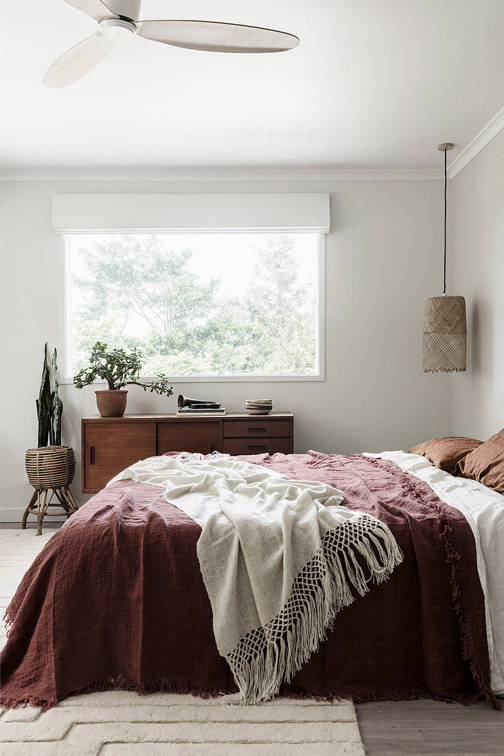 Bedroom in earth colors in boho style