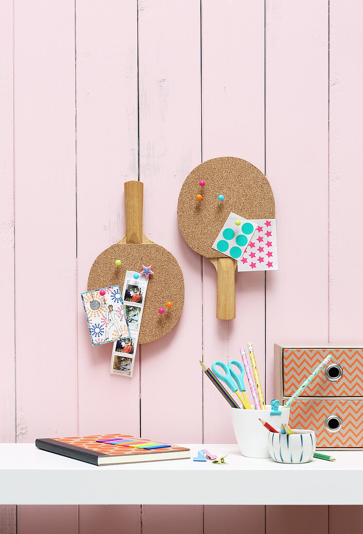 Two pinboards made from cork stuck to table tennis bats