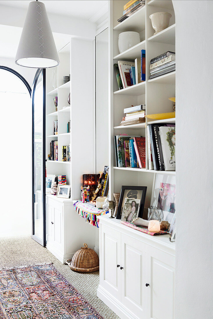 White shelf wall with books in the living room