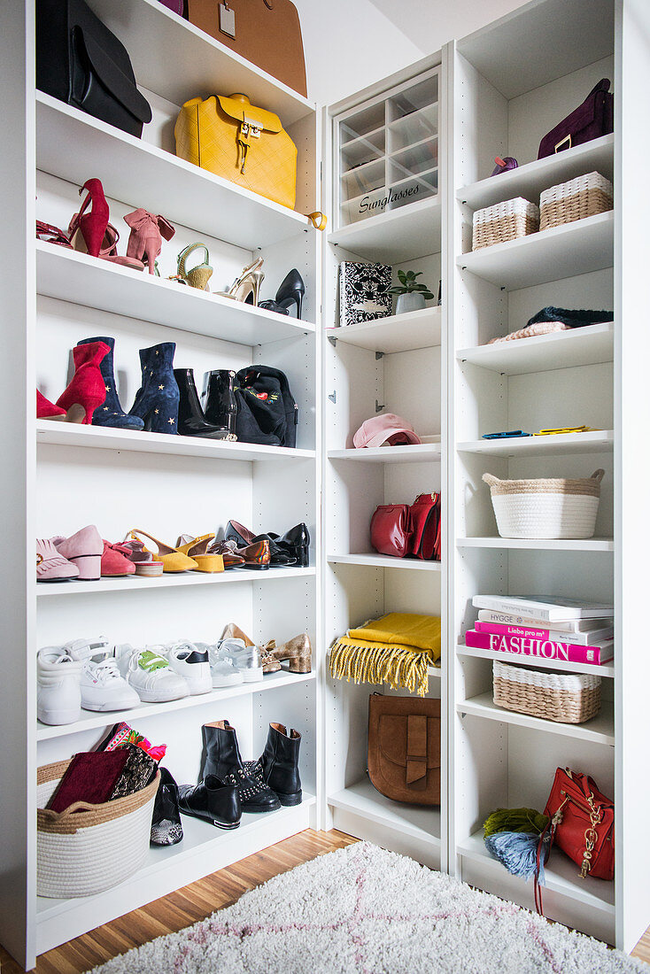 Shoe racks and women's accessories in bright dressing room