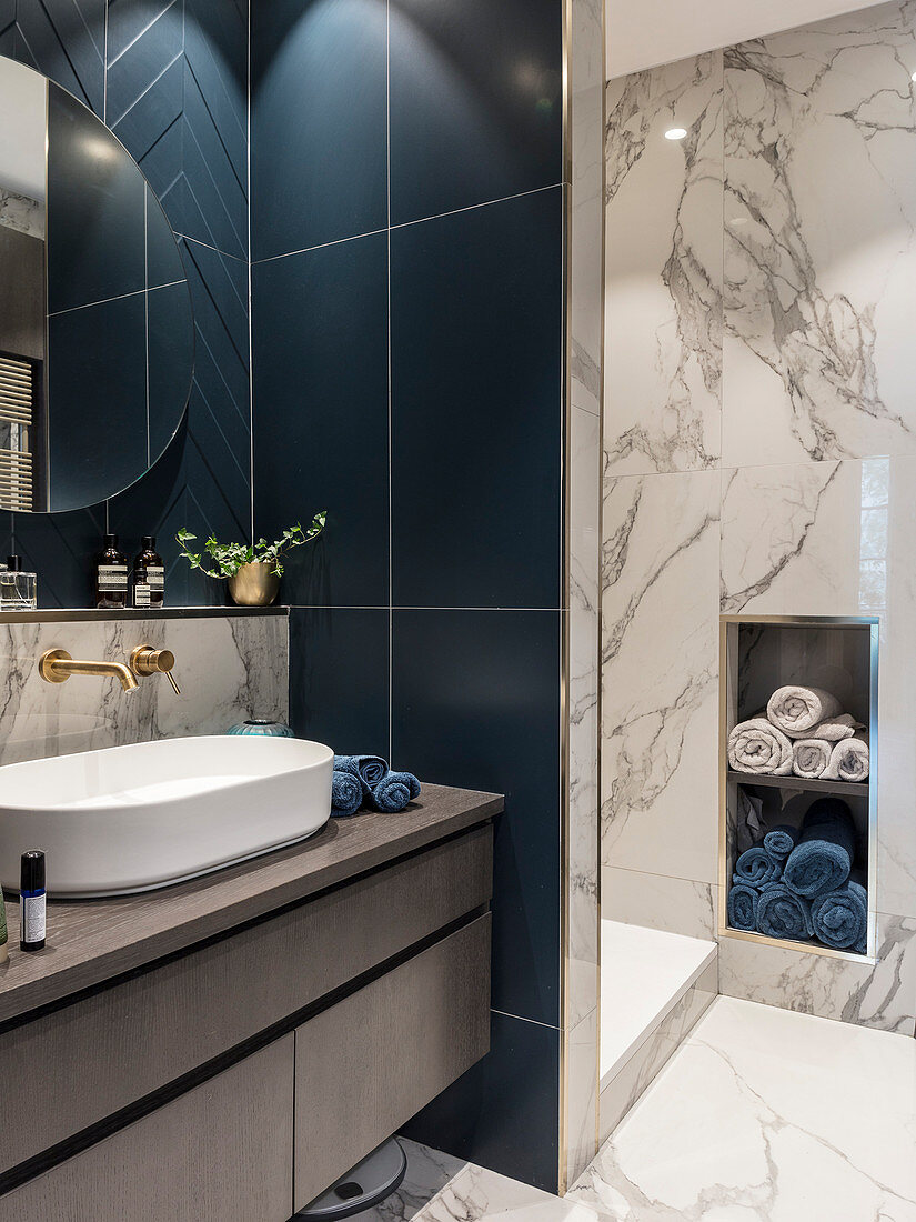 Dark blue tiles and marble surfaces in classic bathroom