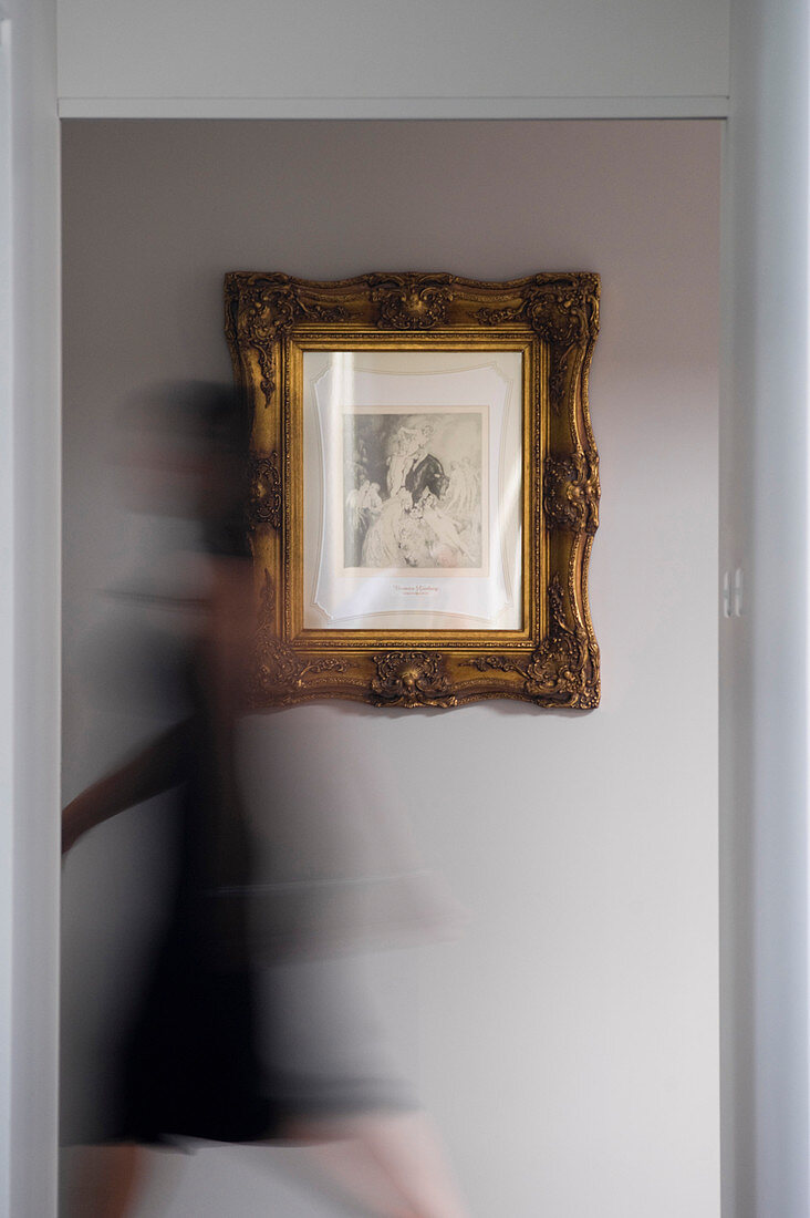 Picture in gilt frame on wall