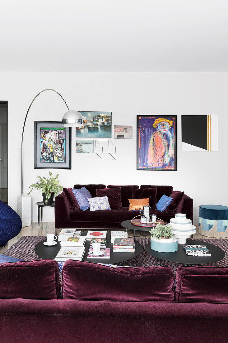 Two purple velvet sofas facing one another in living room
