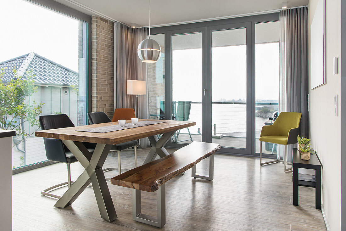 Dining area in interior with floor-to-ceiling windows
