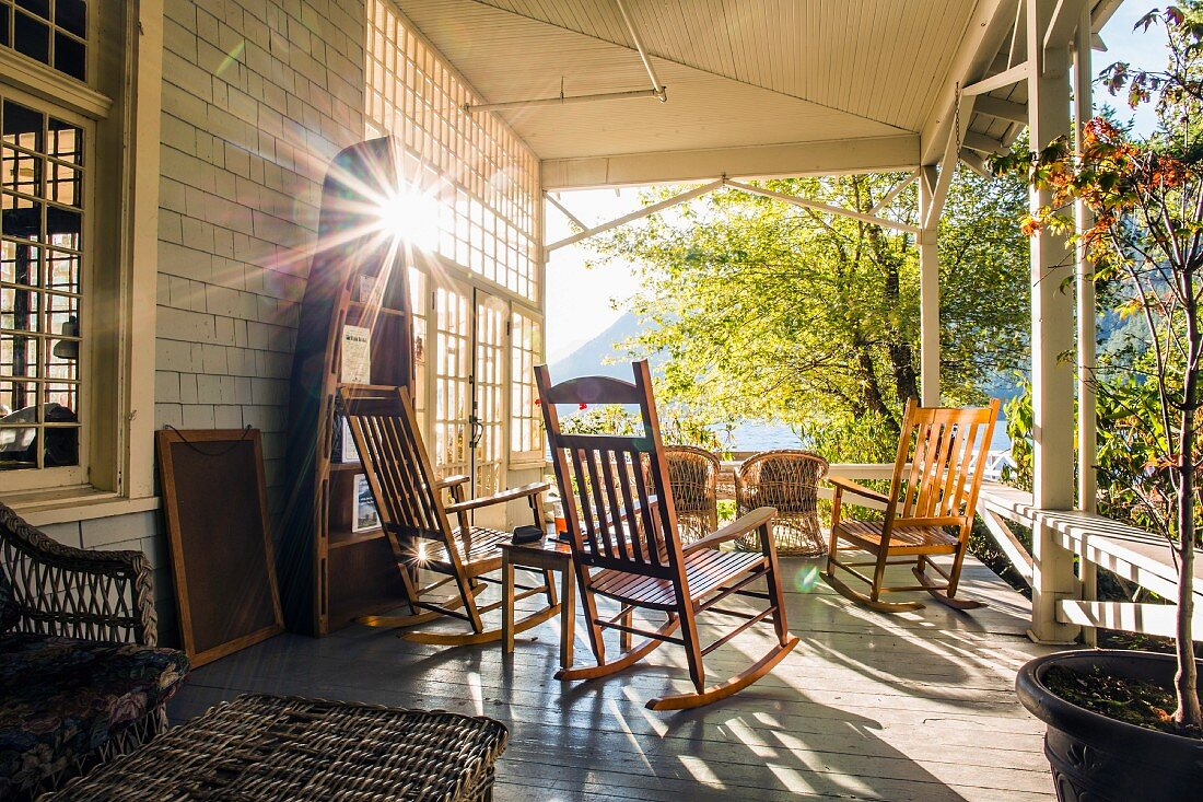 Wooden rocking chairs on sunny veranda