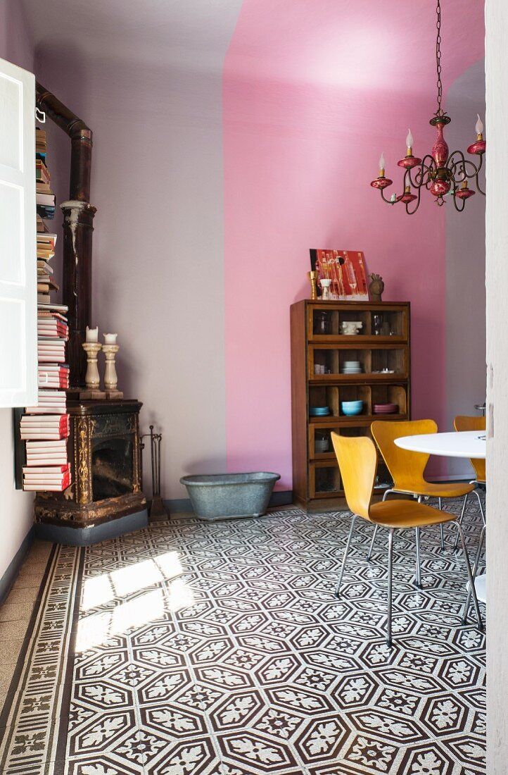 Dining room with patterned floor and two-tone walls and ceiling