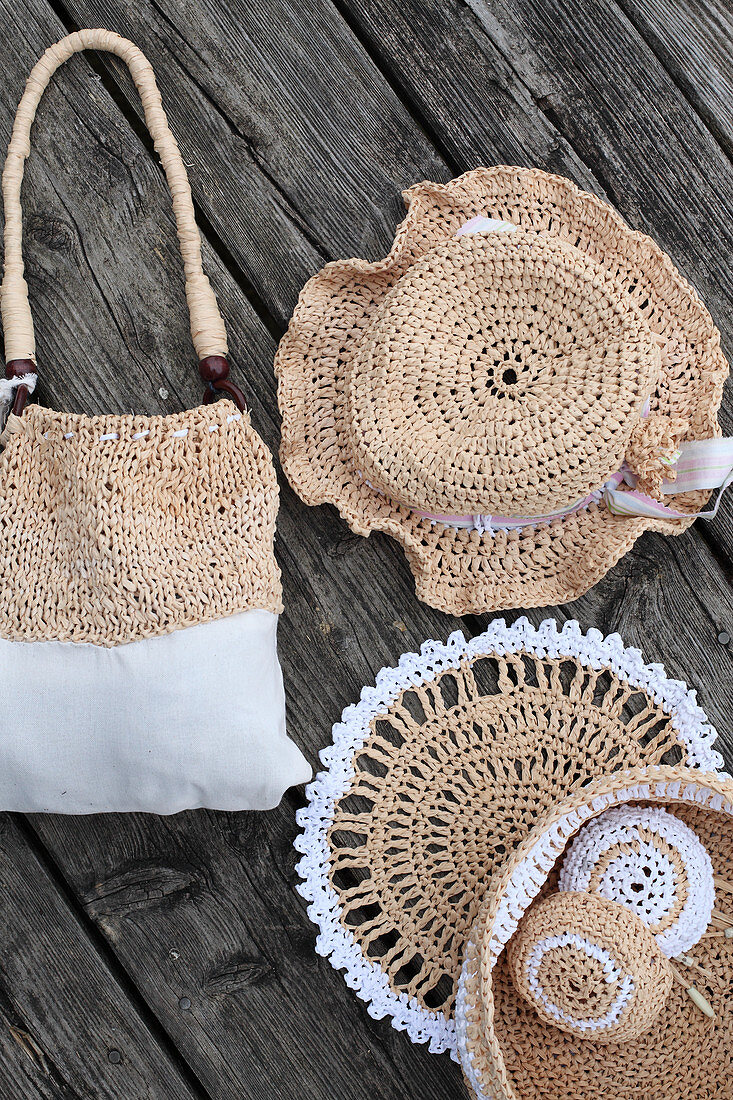 Hand-made raffia accessories: bag, hat, doily and basket