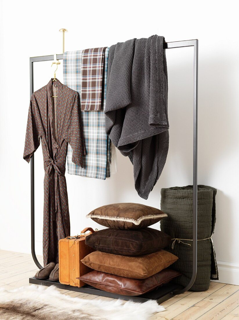 Dressing grown, blankets, leather cushions and briefcase