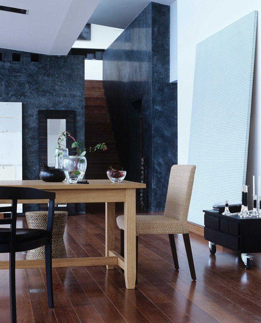 Wooden table and various chairs in elegant interior