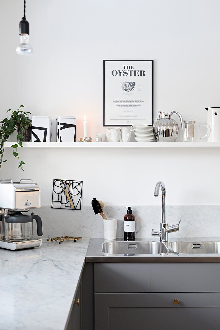 White modern kitchen with open shelves above marble counter