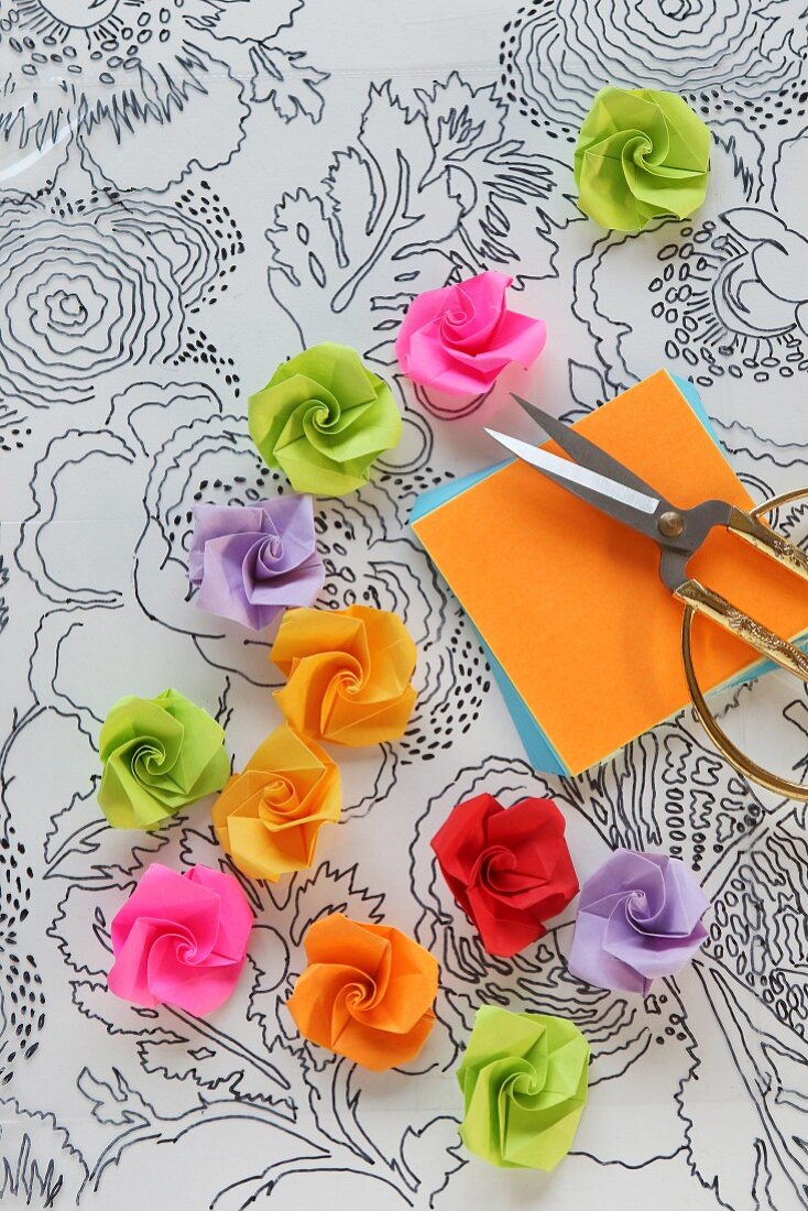 Paper roses on transparency with hand-drawn floral pattern