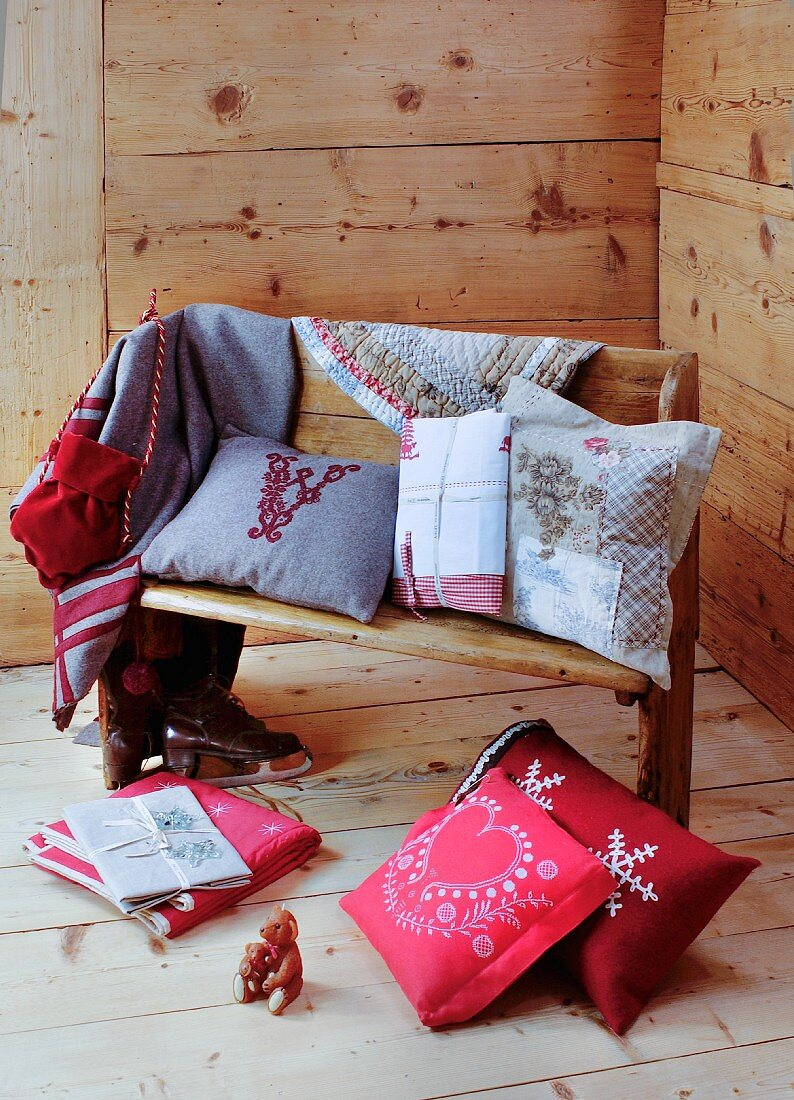 Alpine-style cushions and accessories on wooden bench