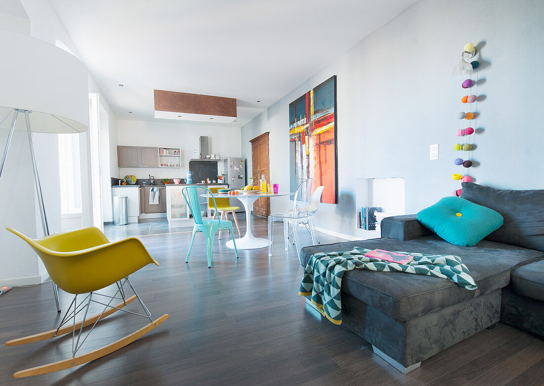 Sofa, dining table and open-plan kitchen in spacious interior