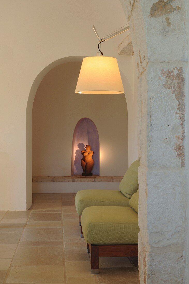 Illuminated statue of woman in niche in trullo