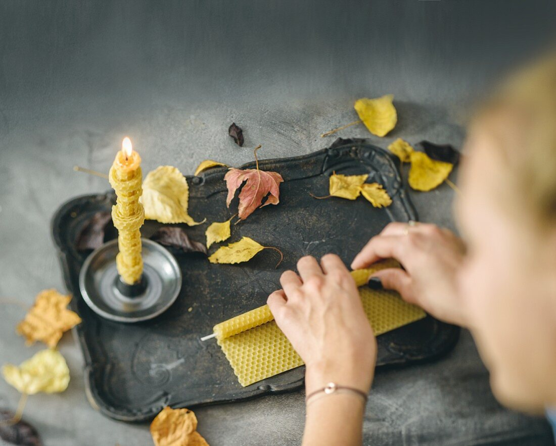 Hand-rolling candles from a beeswax sheet