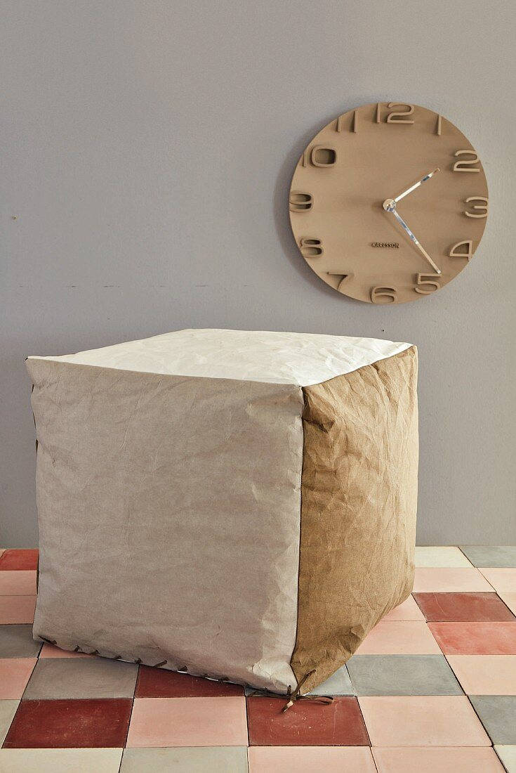 A cube seat made of vegan leather paper
