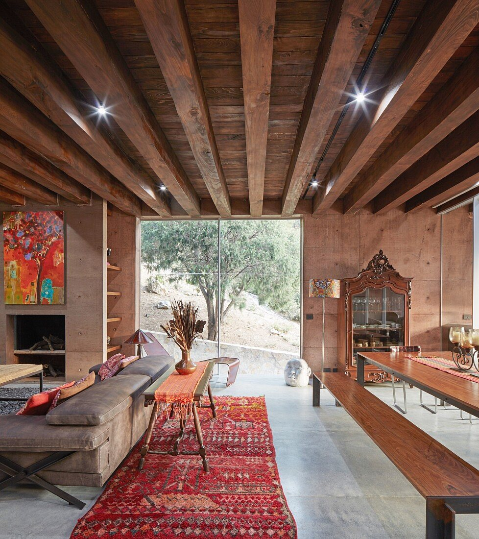 Ethnic-style living room with striking ceiling structure