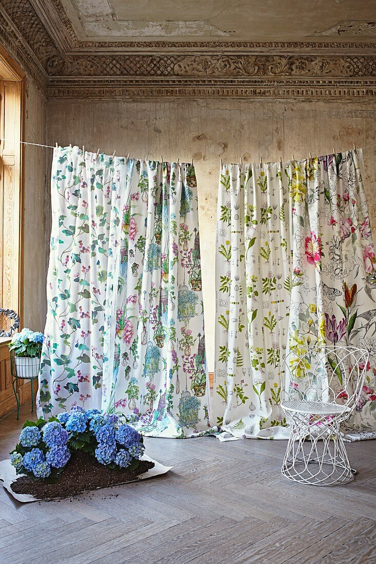 Lengths of fabric with romantic floral patterns