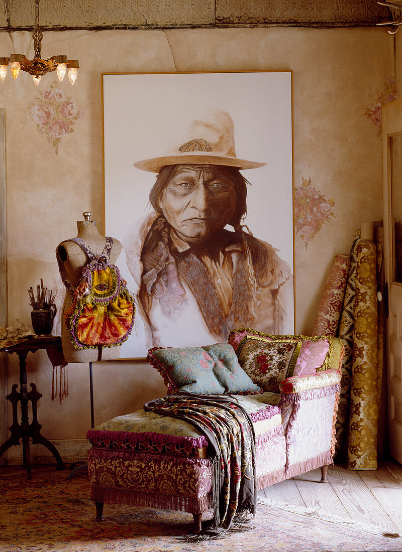 Récamier and tailors' dummy in front of large portrait of Native American